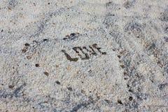 Amour sur la plage de marbre Image stock