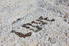 Amour sur la plage de marbre Images stock