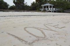 Amour sur la plage de sable Photo stock