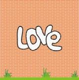 Amour sur le mur de briques Photos libres de droits