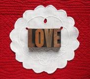 Amour sur le napperon de toile images libres de droits