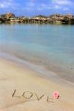 Amour sur le sable de mer Image libre de droits
