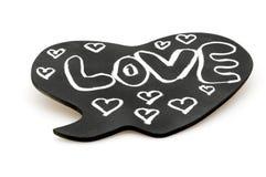 Amour sur le tableau de coeur Image libre de droits