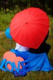 Amour sur un parapluie rouge image stock