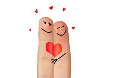 Amour symbolisé avec deux doigts Photos stock