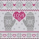 AMOUR tricoté et mitaines de coeur Images stock