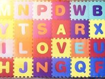 Amour u de l'alphabet i à bord Photographie stock libre de droits