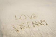 Amour Vietnam écrit en sable Image stock