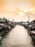Ampawa floating market. AMPAWA - OCT 2015 : the favourite floating market in Samut Songkram Provine thailand, with golden sunshine in evening royalty free stock photography