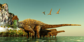 Ampelosaurus Dinosaurs. Wade out into the water to eat underwater vegetation in the Cretaceous Period Royalty Free Stock Images