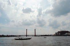Ampera bridge, Musi river and boats. royalty free stock photos