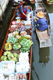 AMPHAWA – APRIL 29: Wooden boats are loaded with fruits from the orchards at Tha kha floating market Royalty Free Stock Images