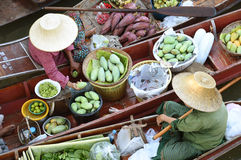 AMPHAWA – APRIL 29: Wooden boats are loaded with fruits from the orchards at Tha kha floating market Stock Image
