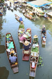 AMPHAWA – APRIL 29: Wooden boats are loaded with fruits from the orchards at Tha kha floating market Royalty Free Stock Photo