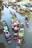 AMPHAWA – APRIL 29: Wooden boats are loaded with fruits from the orchards at Tha kha floating market Stock Images
