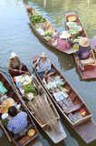 AMPHAWA – APRIL 29: Wooden boats are loaded with fruits from the orchards at Tha kha floating market Stock Photos