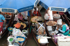 Amphawa evening floating market in Middle of Thailand. Royalty Free Stock Photography