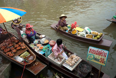 Amphawa evening floating market in Middle of Thailand. Royalty Free Stock Image