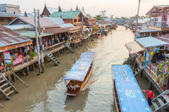 Amphawa floating market in the evening. AMPHAWA, THAILAND -13 MAR 2016 : Amphawa floating market in the evening, It is famous floating market and tourist royalty free stock image