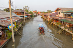 Amphawa floating market in the evening. AMPHAWA, THAILAND -13 MAR 2016 : Amphawa floating market in the evening, It is famous floating market and tourist stock photo