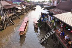 Amphawa Floating Market. On Amphawa Floating maket many of the huse lining the canal are doubling as shops restaurants at Samut Songkram Thailand on may 5, 2012 royalty free stock photography