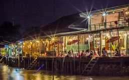 Amphawa Floating Market,Samut Songkhram Province,Thailand on April 12,2019:Homestays along Amphawa canal at night stock photos