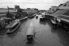 Amphawa floating market in Samut Songkhram, Thailand. SAMUT SONGKHRAM, THAILAND - AUGUST 12: Boats carrying tourists runs along the canal on August 12, 2012 in stock photo