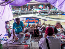Amphawa floating market Tourism in the province are popular . Ea. T plenty of tourist and souvenir of the province in which popular . The people of Thailand And Stock Photography
