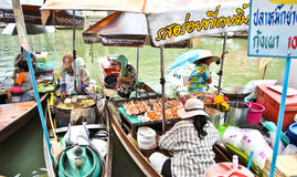 Amphawa Floting Market in Thailand. Amphawa  is an afternoon floating market by the canal near Wat Amphawan Chetiyaram (parking area is available). On Friday Royalty Free Stock Photo