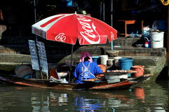 Amphawa, Thailand: Boatwoman at Floating Market Stock Photo