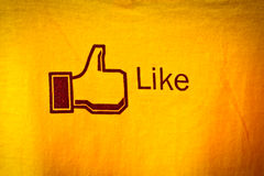 Amphawa, Thailand - Dec 29, 2012: Facebook like icon on fabric, Royalty Free Stock Images