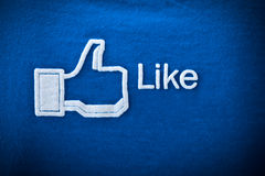 Amphawa, Thailand - Dec 29, 2012: Facebook like icon on fabric,. Facebook is largest social networking website in the world Royalty Free Stock Image