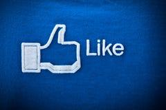 Amphawa, Thailand - Dec 29, 2012: Facebook like icon on fabric, Royalty Free Stock Image