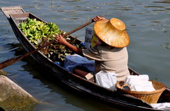 Amphawa, Thailand: Woman Paddling Boat Royalty Free Stock Photos