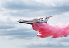 Amphibian aircraft B200 flies and demonstrates the discharge of water when extinguishing the fire. International aviation and space salon in Zhukovsky. Amphibian Stock Photography