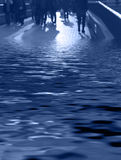 The amphibians-blue. Abstract image of business people and their shadows walking on a pavement bridge partial covered in flood water-blue tones Stock Photo