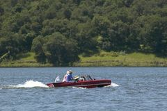 Amphibious convertible car floating down Lake Casitas on a summer day in Ojai, California Royalty Free Stock Images