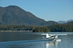 Amphibious plane land on a lake Royalty Free Stock Photography