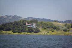 Amphibious seaplane landing on Lake Casitas, Ojai, California royalty free stock images