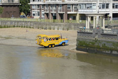 Amphibious tourist bus on River Thames. London UK. Duck Tours amphibious tourist bus leaving the River Thames on the South Bank in London, England Royalty Free Stock Images