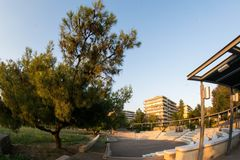 Amphiitheater near a park. A picture of a big amphitheater near a green park and buildings,in a town in Greece,Thessaloniki,in a summer day afternoon Royalty Free Stock Image