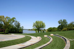 Amphitheater. Outdoor amphitheater in the park by the lake on a clear day Royalty Free Stock Photo