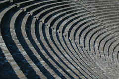Amphitheater. The play of light and shade - semicircular seats in an amphitheater Royalty Free Stock Images