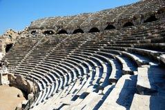 Amphitheater antigo no lado, Turquia Imagem de Stock