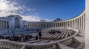 Amphitheater at Arlington National Cemetery. Arlington, VA, USA - Mar 25, 2018.  Memorial Amphitheater at Arlington National Cemetery with many visiters at the Stock Image