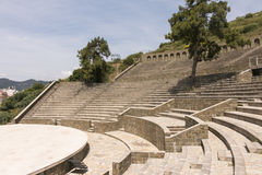Amphitheater. Clear sunny day, delicate clouds Stock Image