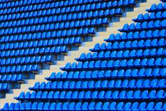 Amphitheater of dark blue seats. With pass between sectors Stock Photography