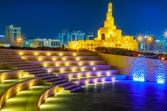 Amphitheater Doha night. Stairs of small amphitheater at Souq Waqif Garden near Doha Corniche with Doha mosque at night. Doha city center in Qatar, Middle East stock photo