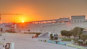 Amphitheater in Katara cultural village with sunset timelapse, Doha Qatar. Aerial top view. People walking in front of fountain stock video