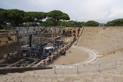 Amphitheater at Ostia Antica. This picture was taken while concert preparations were taking place there.nnRuins of Ostia Antica represent a large archeological stock photography
